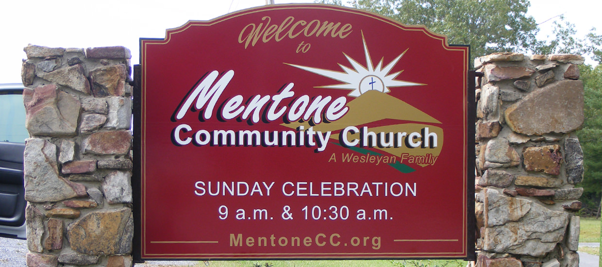 Shaped sign for Mentone Community Church, located in Mentone, Alabama.