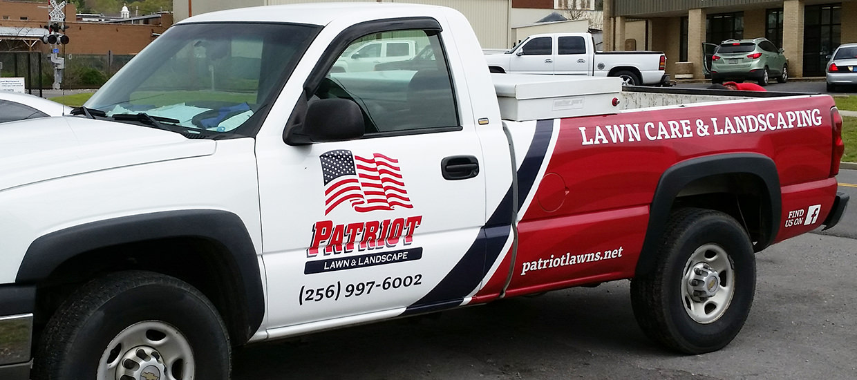 Partial truck wrap for Patriot Lawn and Landscape.