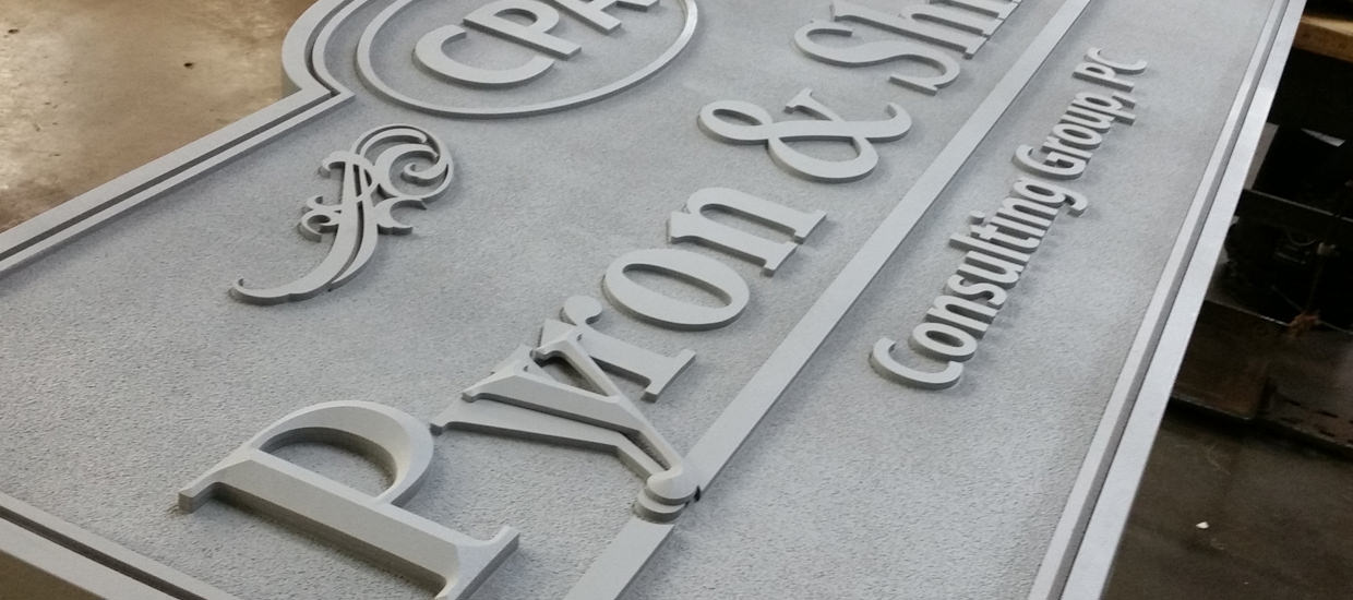 Work in progress of Pyron & Shirey Consulting Group's sandblasted sign.