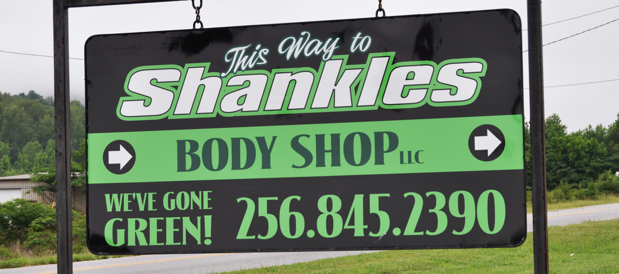 Polymetal sign for Shankles Body Shop, located in Fort Payne, Alabama.