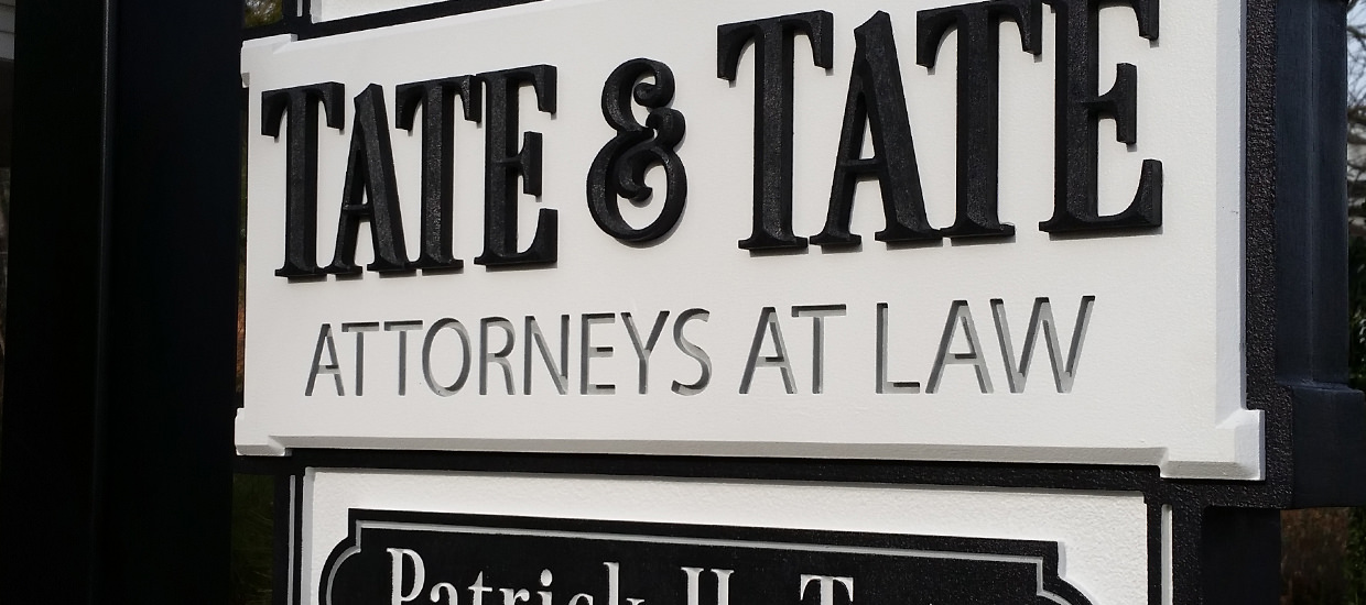 Sandblasted sign for Tate & Tate, an Alabama-based law firm.