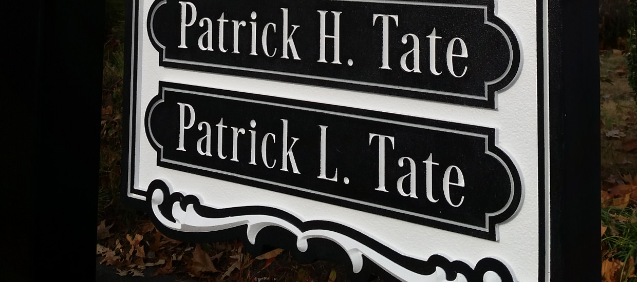Sandblasted sign for Tate & Tate, a father-and-son law firm.