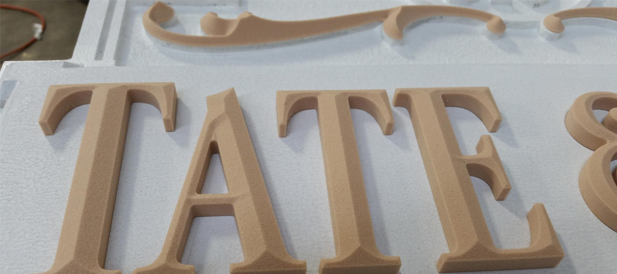 Work in progress picture of Tate & Tate's sandblasted sign.