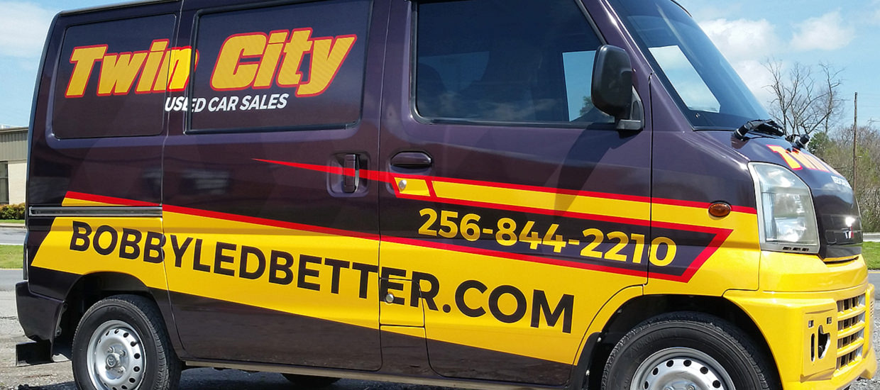 Vehicle wrap design for a vendor of Twin City Used Car Sales, a used automobile dealer.