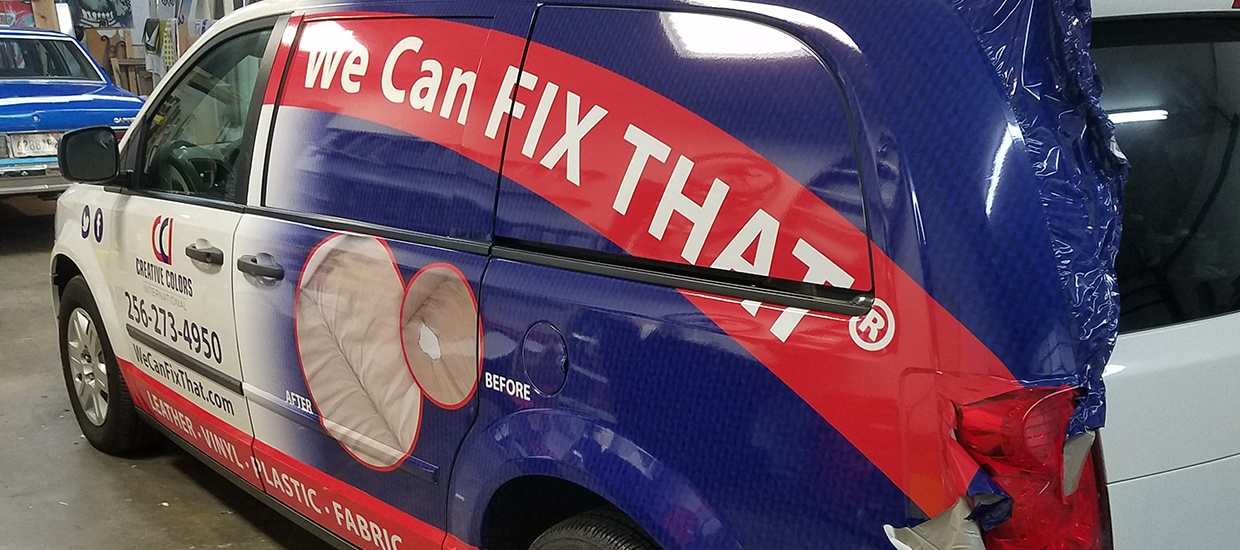 Van wrap installation in progress for a Creative Colors contractor.