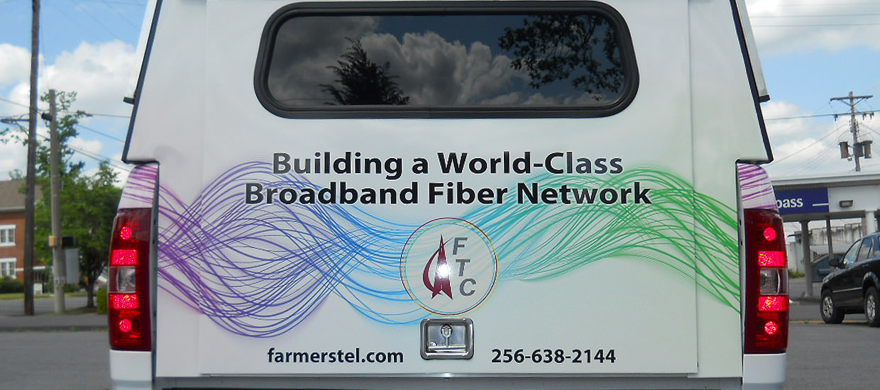 Partial vehicle wrap design for Farmers Telecommunications, A telecommunications company located in Rainsville, AL