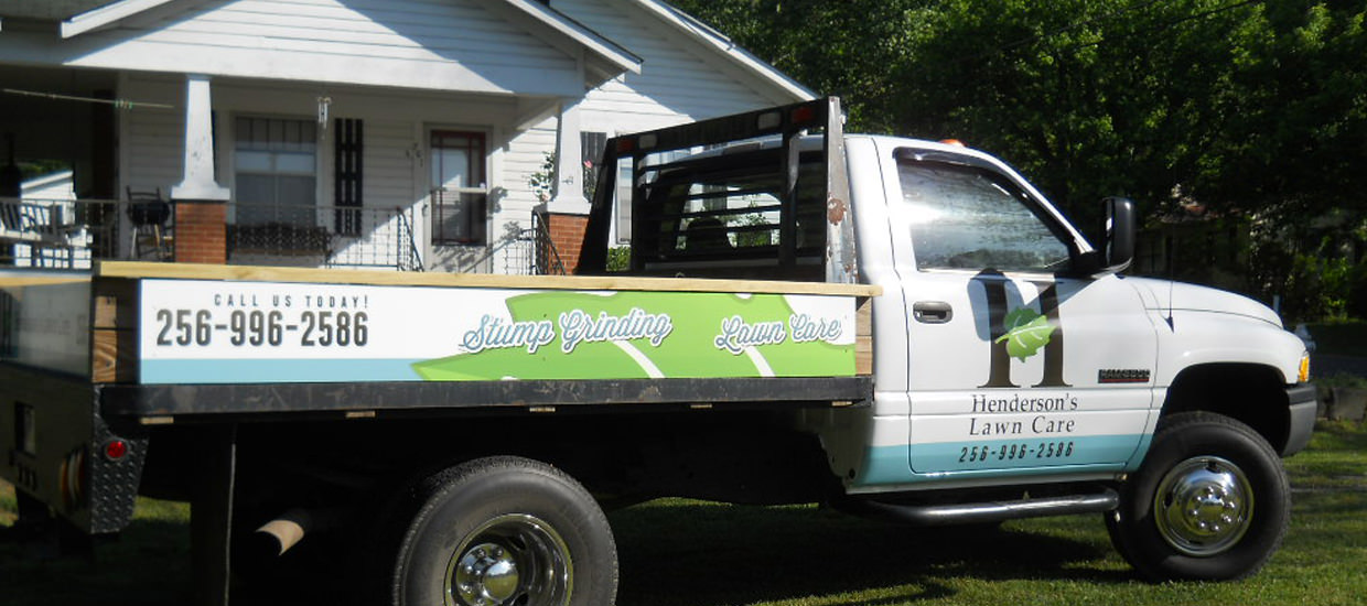 Partial vehicle wrap design for Henderson's Lawn Care, a lawn care service.