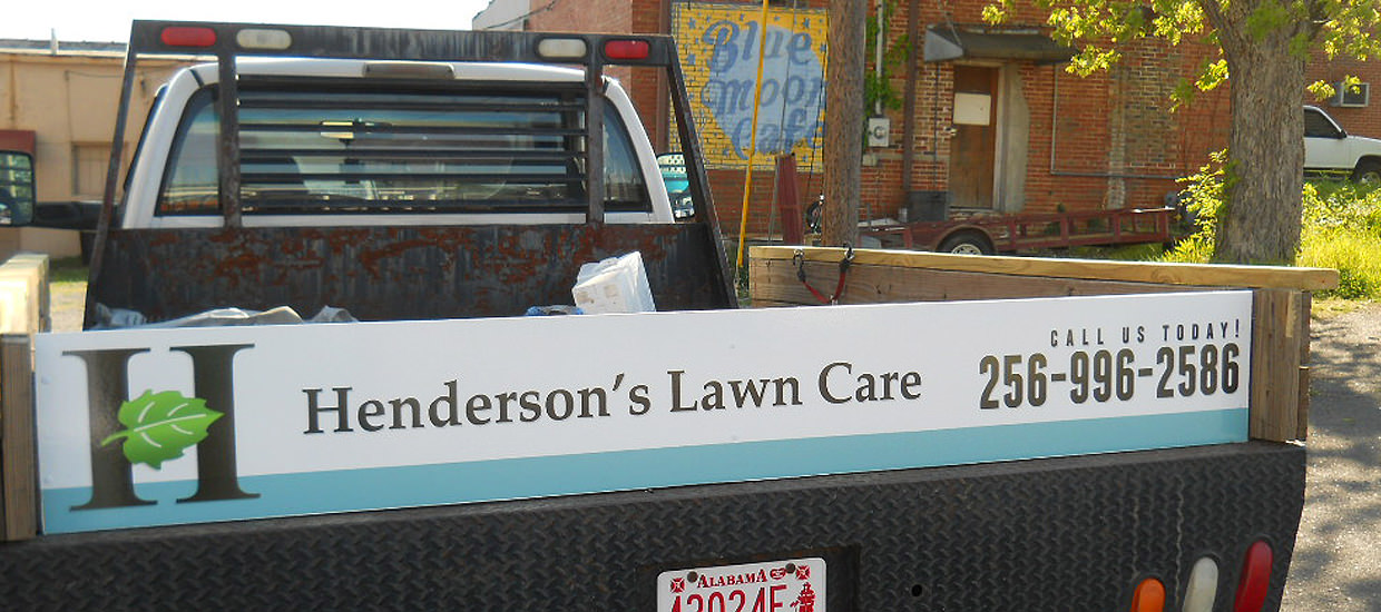 Partial vehicle wrap design for Henderson's Lawn Care, located in Alabama.