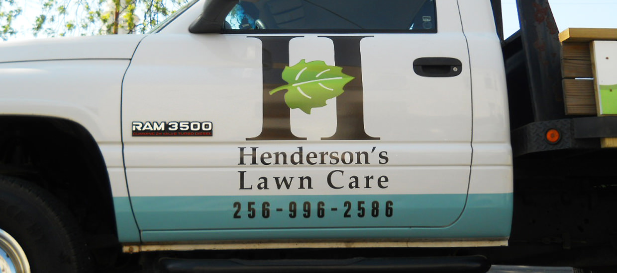 Partial vehicle wrap design for Henderson's Lawn Care, a Northeast Alabama lawn care service.