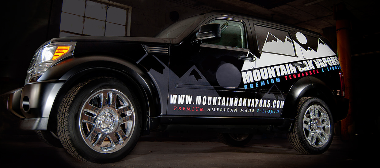 Full vehicle wrap for Mountain Oak Vapors, an e-cigarette, e-liquid, and vaporizer shop located in Chattanooga, TN.