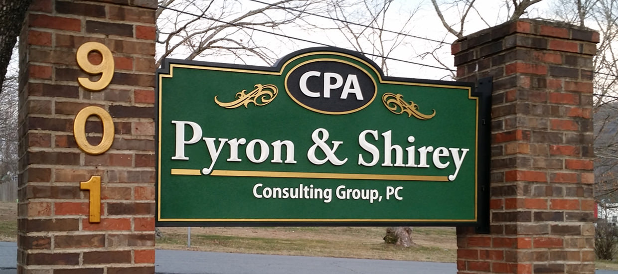 Sandblasted sign for Pyron & Shirey Consulting Group, a Certified Public Accountant firm.