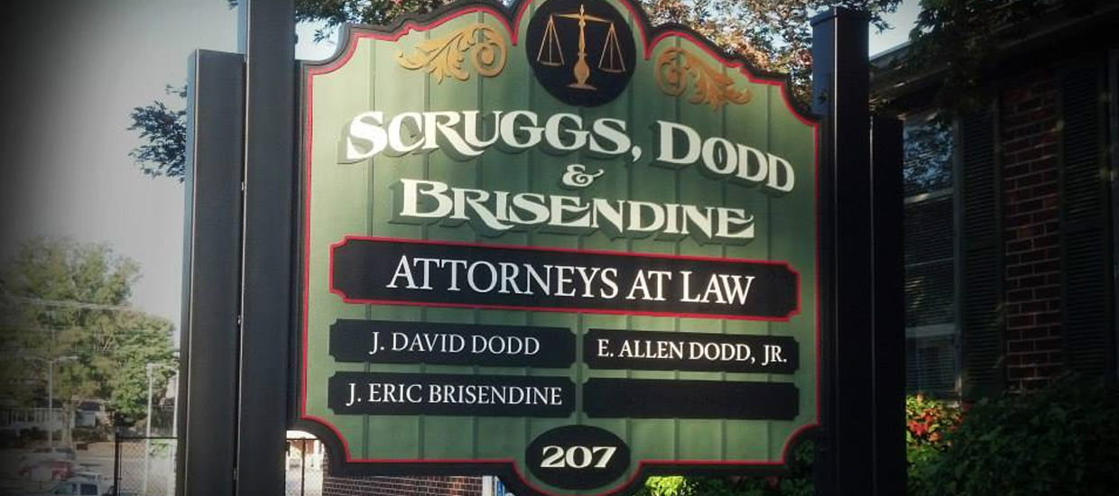 Sandblasted sign for Scruggs, Dodd & Brisendine.