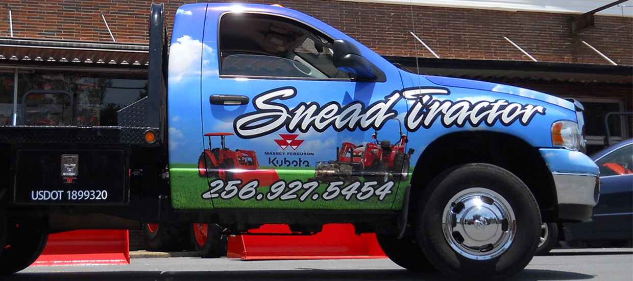 Vehicle Wrap for Snead Tractor, a Northeast Alabama farming and agricultural sales company.