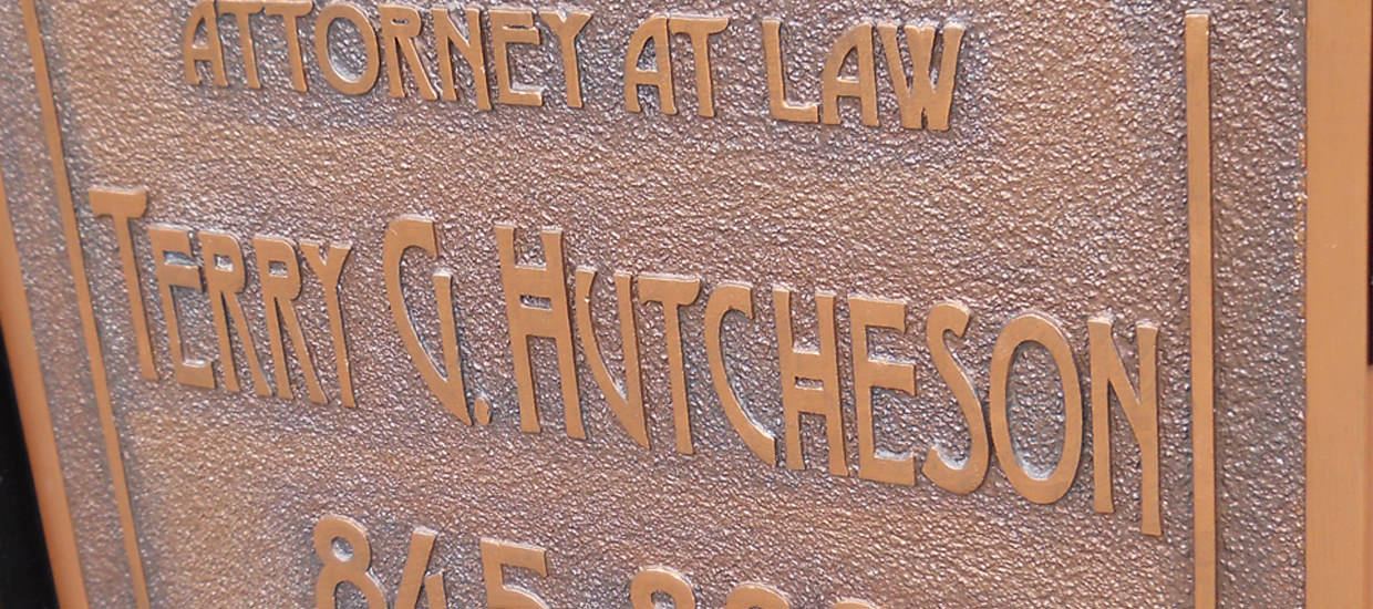 Sandblasted sign for Terry G. Hutcheson, a Northeast Alabama attorney.