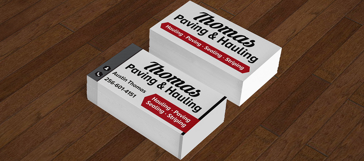 Business cards for Thomas Paving and Hauling