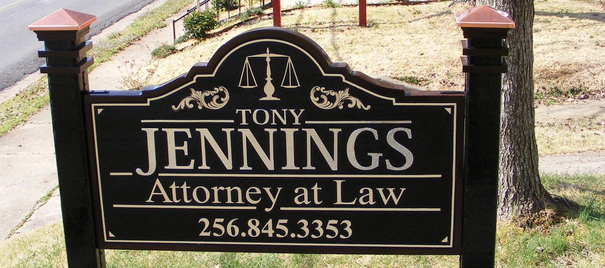 Sandblasted sign for Tony Jennings, an attorney located in Fort Payne, Alabama.