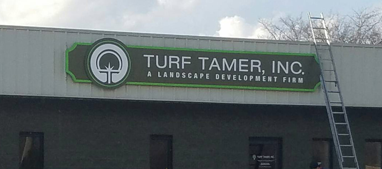 Dimensional sign for Turf Tamer, a lawn care provider in Fort Payne, AL.