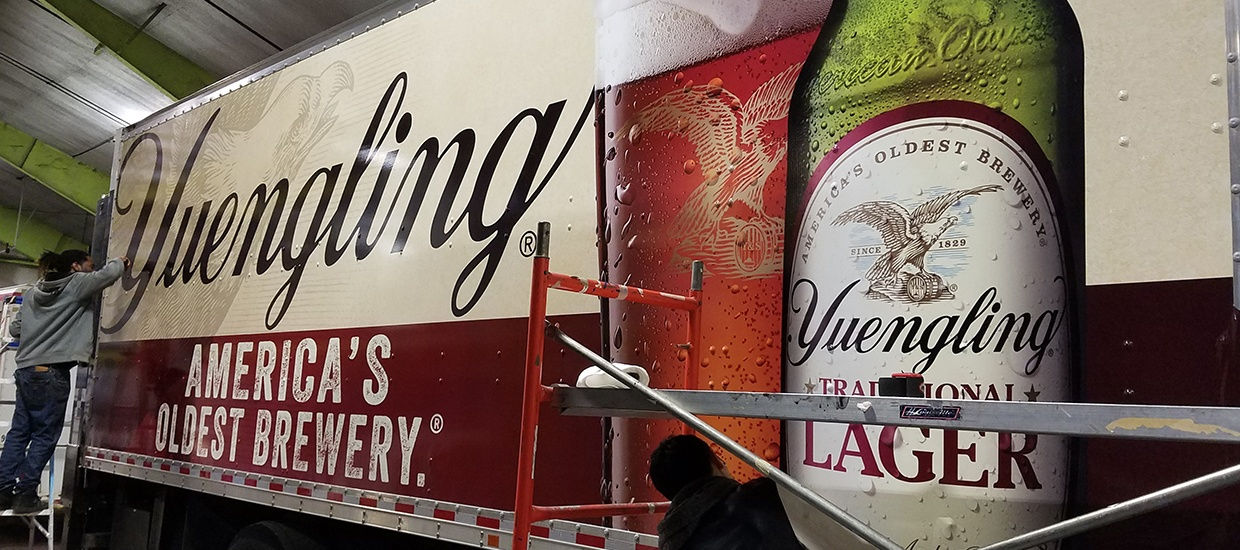 Yuengling box truck wrap installation.