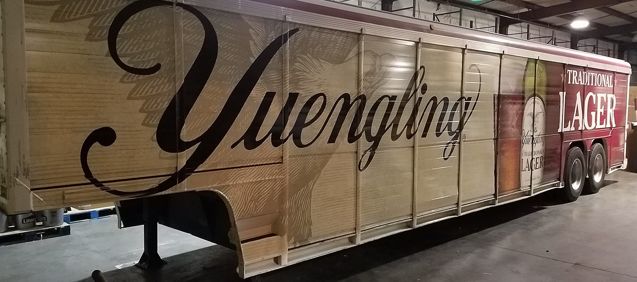 Yuengling beer truck wrap installation.